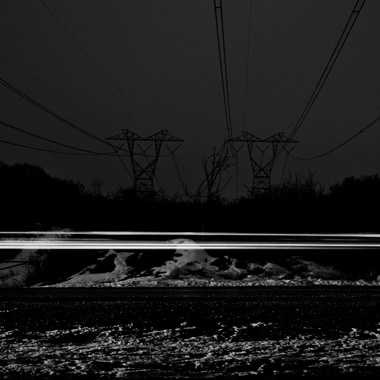 Black and white extended exposure photograph of car light trail in woods in Huntingdon, Pennsylvania